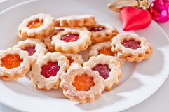 Homemade biscuits filled with jam. Biscuits filled with jam and powdered with sugar Royalty Free Stock Photo