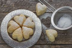 Homemade biscuits in the form of hearts. Stock Photos