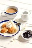 Homemade biscuits, meringues and tea with milk Stock Photography