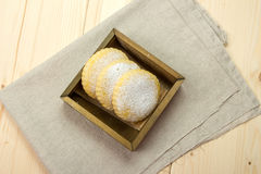 Homemade biscuits milk with powdered sugar in a wooden box Royalty Free Stock Photos