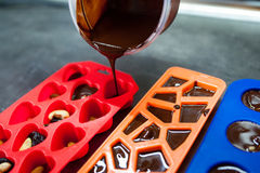 Homemade black chocolate handmade poured into plastic molds.  Royalty Free Stock Photography