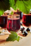 Homemade black currant liqueur and fresh berries. Homemade black currant liqueur and fresh berries, wooden background stock photos