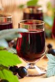 Homemade black currant liqueur and fresh berries. Homemade black currant liqueur and fresh berries, wooden background stock image