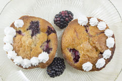 Homemade blackberry fruit muffins decorated with cream and fresh Stock Photos