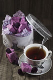 Homemade blackberry marshmallow. Homemade violet blackberry marshmallow with cup of tea Stock Photos