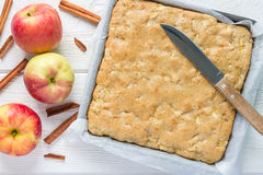 Homemade blondie brownies apple cake in baking dish, top view. Homemade blondie (blonde) brownies apple cake in baking dish, horizontal, top view Stock Photos
