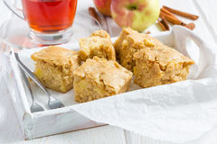 Homemade blondie brownies apple cake, square slices in wooden tray. Homemade blondie (blonde) brownies apple cake, square slices in wooden tray, horizontal Stock Photos