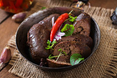 Homemade blood sausage with offal Stock Photo