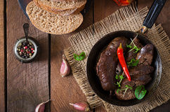 Homemade blood sausage with offal on the old wooden background in rustic style. Stock Photos
