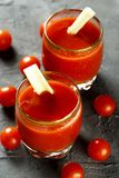 Homemade Bloody Mary tomato cocktail. Served with fresh celery stock photography