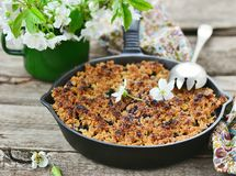 Homemade blueberry crumble on wooden table. Homemade blueberry crumble on rustic wooden table stock photo