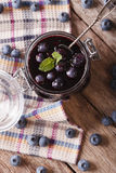 Homemade blueberry jam in a glass jar. vertical top view Royalty Free Stock Image