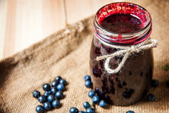Homemade blueberry jam in a jar and fresh blueberries Stock Photo