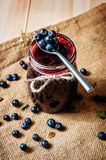 Homemade blueberry jam in a jar and fresh blueberries Stock Photos