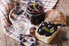 Homemade blueberry jam and sweet bun close-up. horizontal Stock Photos