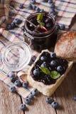 Homemade blueberry jam and sweet bun close-up. vertical Royalty Free Stock Photos