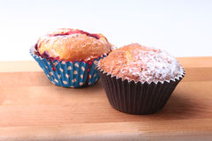 Homemade Blueberry muffins with powdered sugar and fresh berries. Stock Image