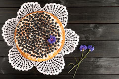 Homemade blueberry pie on a black wooden background. Stock Photography