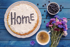 Homemade blueberry pie with a cup of coffee and a bouquet of flo Stock Image