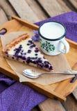 Homemade blueberry tart pie and milk Stock Image