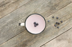 Homemade blueberry yogurt in a cup. On rustic wooden table. Healthy food, clean eating . Top view stock image