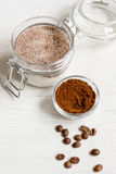 Homemade body peeling cocoa-sugar on wooden background close up Royalty Free Stock Photography