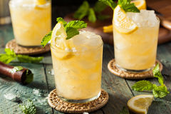 Homemade Boozy Bourbon Whiskey Smash. With Lemon and Mint royalty free stock photos