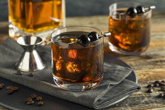 Homemade Boozy Coffee Old Fashioned. With Bourbon and Cherries stock photos