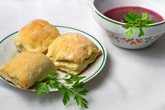 Homemade borsch with small pie Royalty Free Stock Photography