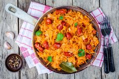 Homemade braised sauerkraut with smoked sausages in a frying pan Royalty Free Stock Images