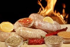 Homemade Bratwurst Sausage in fire background XXXL Royalty Free Stock Photo