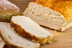 Homemade bread. A loaf of homemade bread on a breadboard Royalty Free Stock Images