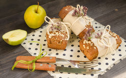 Homemade bread with apples in wrapping paper and apple on linen Royalty Free Stock Image