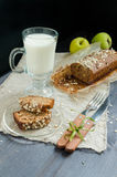 Homemade bread with apples in wrapping paper and glass of milk on white plate Royalty Free Stock Image