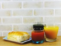 Homemade bread with bacon ham pork mayonnaise and fruit juice Stock Image