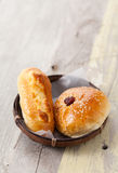 Homemade bread in basket on wooden table, Selective focus Stock Image