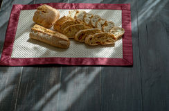 Homemade Bread. On black table under the natural sun light stock images