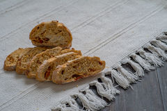 Homemade Bread. On black table under the natural sun light royalty free stock photography
