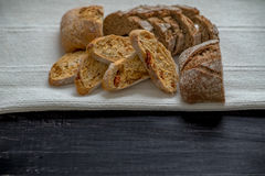 Homemade Bread. On black table under the natural sun light royalty free stock photo