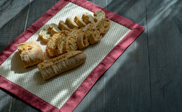 Homemade Bread. On black table under the natural sun light royalty free stock images