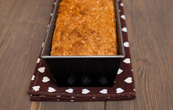 Homemade bread with cereals. Homemade brown bread with cereals in a baking dish Stock Photo