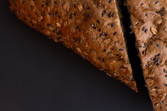 Homemade bread with cereals on a black background. For sample texte on it Royalty Free Stock Images