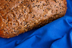 Homemade bread with cereals on a blue background. For sample texte on it Royalty Free Stock Photography