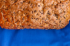 Homemade bread with cereals on a blue background Royalty Free Stock Image