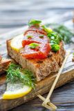 Homemade bread with cheese, herring caviar and chives. Royalty Free Stock Images