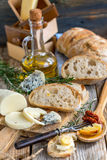 Homemade bread, cheese and olive oil. Stock Photography