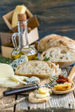 Homemade bread, cheese and olive oil. Stock Image