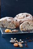 Homemade bread with dried fruis and nuts. On a black background Royalty Free Stock Photo