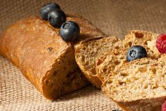 Homemade bread with fresh berries. Black bread with sliced fresh berries Stock Photography