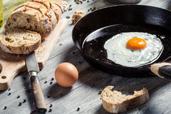 Homemade bread and fried egg Stock Images